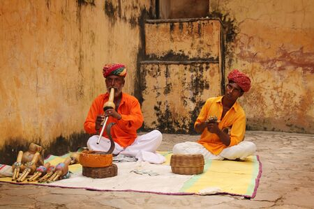 Old snake charmer man with his apprentice in Jaipur, India Stock Photo - 15950756