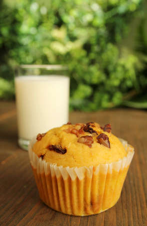 Carrot muffin and a glass of milk  photo
