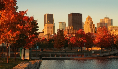 canada: Buildings in the old port of Montreal early in the morning during fall season