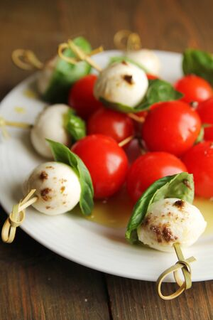 Nice skewer with bocconcini, tomato and basil   Caprese  Stock Photo