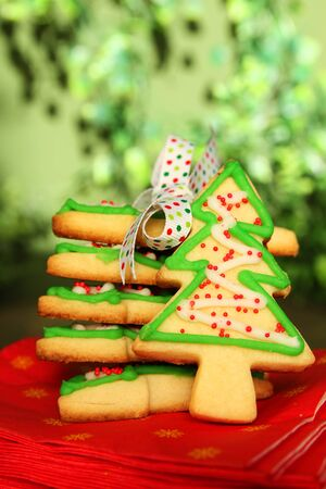 Stack of christmas tree cookies with a ribbon and a cookie photo