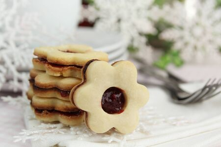 Flowers shape cookies with snowflakes and plate in background