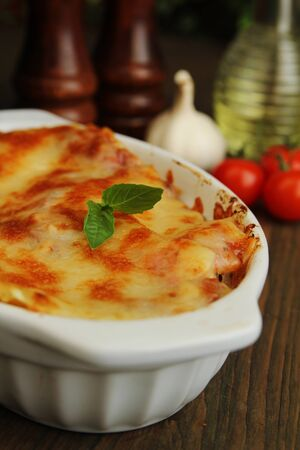 Fresh lasagna with basil ready to eat photo