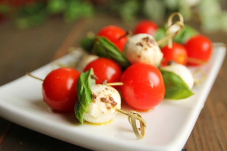 Bocconcini with basil and cherry tomatoes on skewer Stock Photo