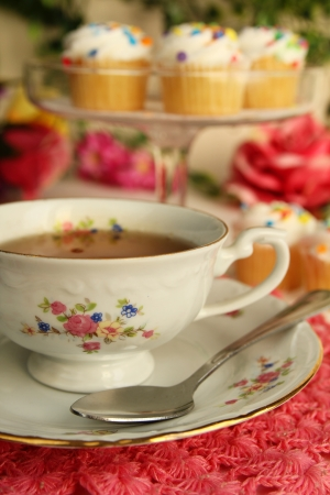 Tea time, a nice cup of tea with little cake photo