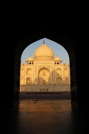 Fabulus Taj Mahal  in Agra, India early in the morning in a silhouette of a arabic door