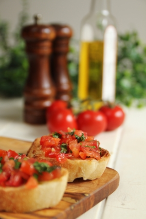 Two bruschettas on wooden board for appetizer photo