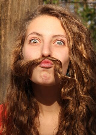 mustaches: Young girl doing mustaches with her hair