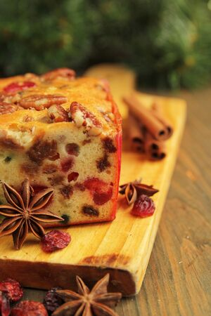 Traditionnal fruit cake for christmas with anise, cinamon and dried cranderries photo