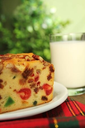Traditional fruit cake for christmas and a glass of milk photo