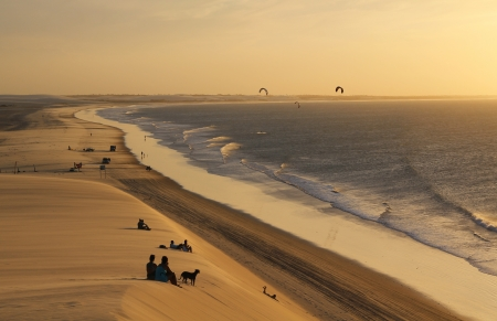 People looking at the sunset on a sand dune in Jericoacoara in Brazil Banco de Imagens