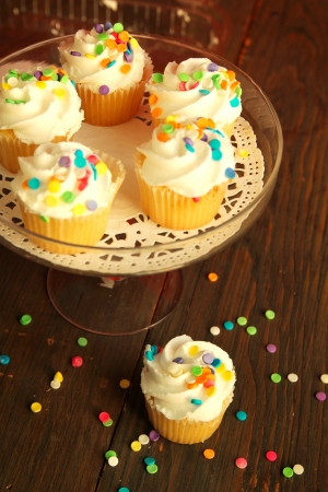 Top view of cupcakes with colorful sprinkles in a stand photo
