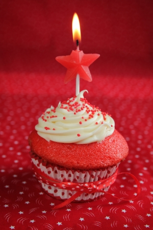 Red velvet cupcakes on a red background
