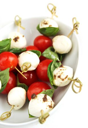 Delicious skewer with boccocini, cherry tomatoes and basil or caprese