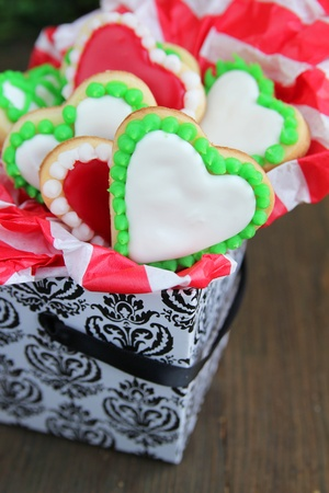 Green and red heart cookies  in a box on a wooden table photo