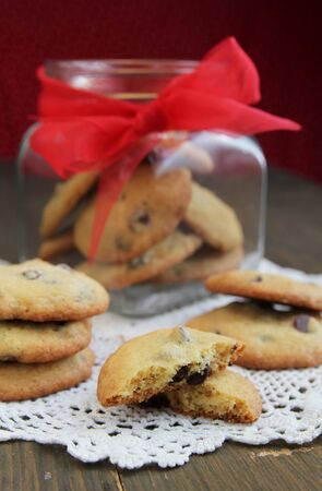 Fresh homemade cookies and a jar on a wooden table photo