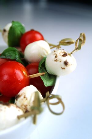 appetiser: Delicious appetiser with boccocini, cherry tomatoes and basil or caprese