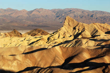 Zabriskie Point surrounded by a maze of vibrantly colored badlands photo