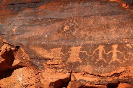 sedimentary: Petroglyphs carved in orange rocks by Navaro at Valley of fire in Nevada state of United State