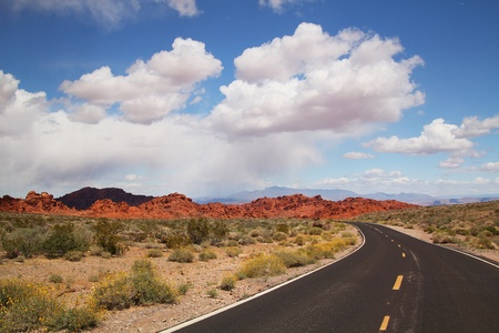 Road to valley of fire with beautiful blue sky full of clouds photo