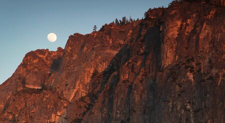 tunnel view: Full moon at sunset from tunnel view at Yosemite national park, in California