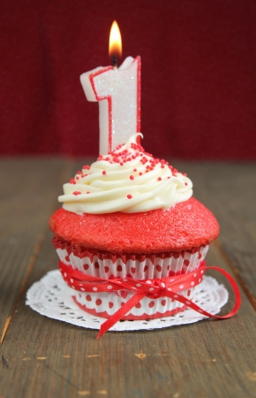 red velvet cupcake: Red velvet cupcake with a number one candle on it