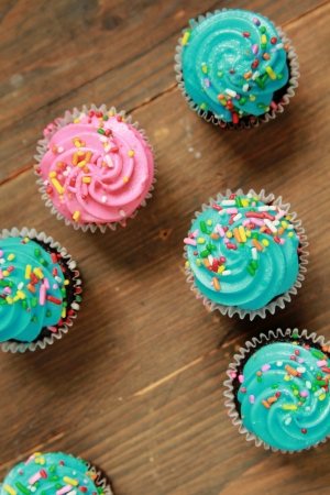 red velvet cupcake: Top view of blue and pink icing cupcakes