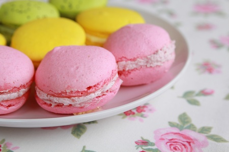 lemon, pistachio and strawberry macarons in a box Stock Photo