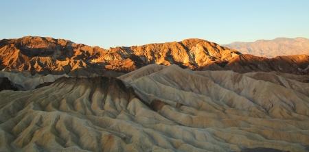 Sunrise light on badlands at Zabriskie point at Death Valley during sunrise photo