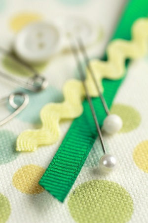 sewing kit: Sewing kit with scisors on piece of material Stock Photo