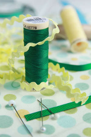 Sewing kit with cisors on piece of material 写真素材