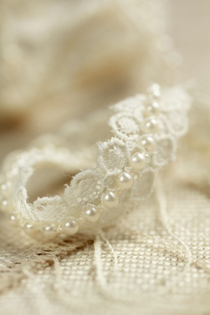 white fabric texture: Nice piece of lace and pearl braid