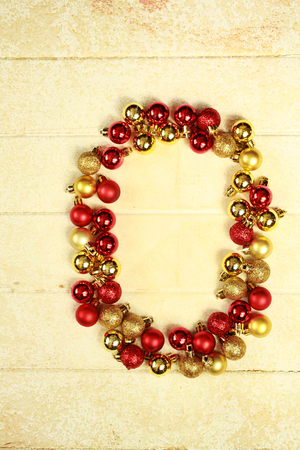 0 1 year: Number zero made with red and gold christmas balls on a vintage background
