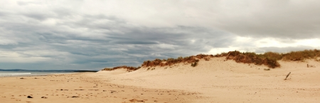 Panorama of sand dunes with dramatic sky at Lossiemouth in Scotland, UK  photo