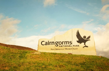 Cairngorms national park sign in a blue sky, in Scotland, UK