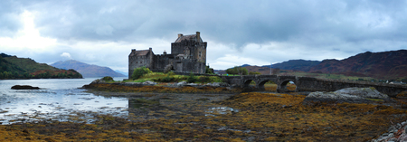 Eilean Donan castle at low tide at dusk in Scotland, UK
