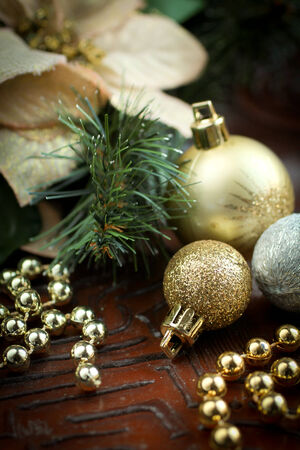 Christmas decoration with christmas balls, golden beads and poinsetia as ornement