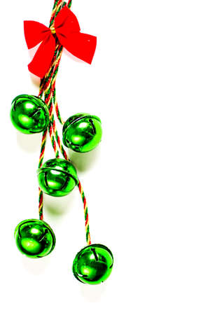 Green bells and red christmas ribbon on a white