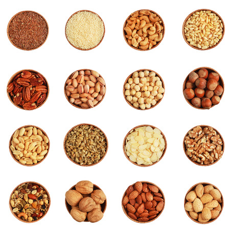 ground nuts: Variety of nuts in a wooden bowl on white