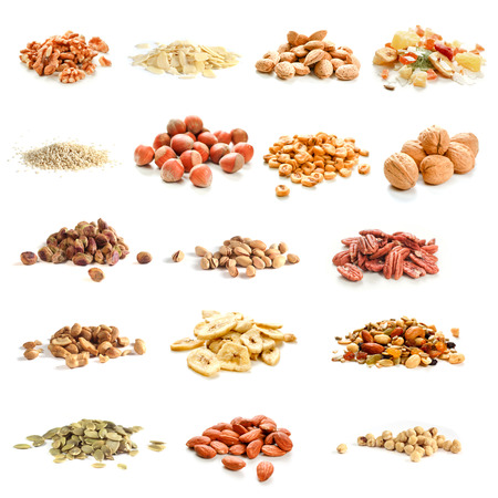 Collection of nuts, seeds and dried fruits on white background photo