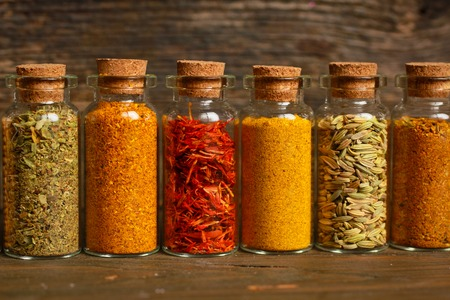 garam: Spices, herbs and seeds for cooking in little jar in a row