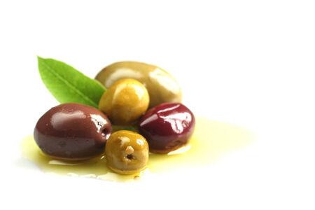 kalamata: Kalamata and green olives into olive oil on white background