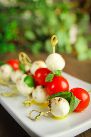 toothpick: Delicious bocconcini, tomato and basil on toothpick