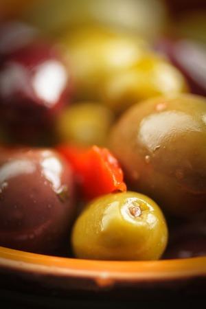 kalamata: Close up of green and kalamata olives into a bowl