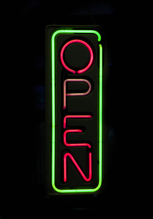 Neon sign red and green of the word  open  on black background photo