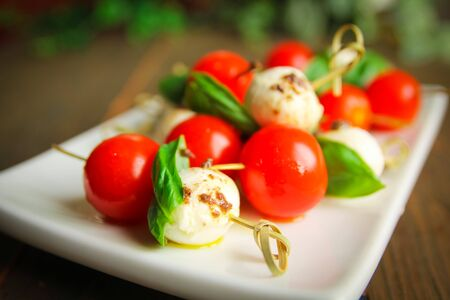 cherry tomatoes: Bocconcini with basil and cherry tomatoes on skewer Stock Photo