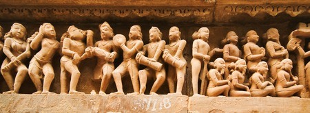 Detail of one of the temple of Khajuraho, showing everyday life, erotism and sexuality