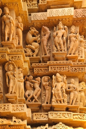 Detail of one of the monument of Khajuraho, showing everyday life, erotism and sexuality