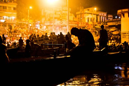 uttar: Silhouette of people looking at Varanasi Ganga Aarti in Varanasi, India Stock Photo