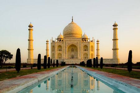 Beautiful Taj Mahal during sunrise with a nice cloudy sky, in Agra, India  photo